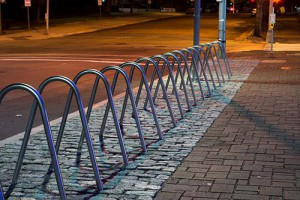 Bike Rack Installation Address the needs of the bikers in the community when you install bike racks outside your property. We have compact single racks and larger racks for multiple bikes. All of these are anchored onto the concrete for durability and safety.